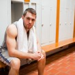 Handsome young sports student sitting on a bench — Stock Photo