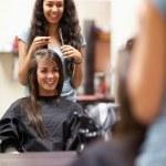 Portrait of a woman making a haircut — Stock Photo