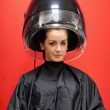 Portrait of a young woman under a hairdressing machine — Stock Photo #11193250