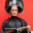 Young woman under a hairdressing machine — Stock Photo