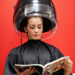 Portrait of a student under a hairdressing machine — Stock Photo