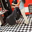 Stock Photo: Portrait of male student having haircut