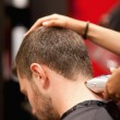Portrait of a male young student having a haircut — Stock Photo #11193290