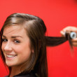 Smiling woman having her hair rolled — Stock Photo #11193315