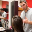 Serious male hairdresser cutting hair — Stock Photo #11193333