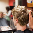 Blond-haired man having a haircut — Stock Photo
