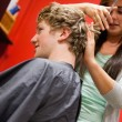 Stock Photo: Portrait of serious womcutting man's hair