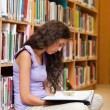 Portrait of a female student reading a book — Foto Stock