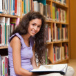 Stock Photo: Portrait of female student with book