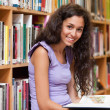 Stock Photo: Young student holding book