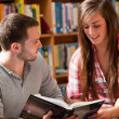 Portrait of students reading a book — Stock Photo
