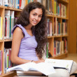 Portrait of a happy student with a book - Stockfoto
