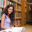 Portrait of a young female student with a book — Stock Photo