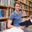 Male student holding a book — Stock Photo