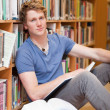 Portrait of a male student with a book — Stock Photo #11193441