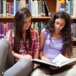 Portrait of female students reading — Stockfoto