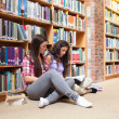 Female students with a book — Stockfoto