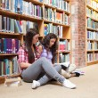 Female students with a book — ストック写真