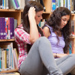 Female students reading a book — Stockfoto