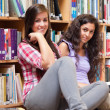 Female students holding a book — Stockfoto
