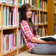 Cute female student holding a book — Foto Stock