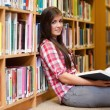 Stock Photo: Cute female student holding book