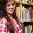 Portrait of a smiling female student — Stock Photo