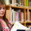 Female student reading - Stockfoto