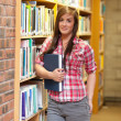 Portrait of a young student holding a book - Photo