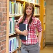 Portrait of a young student holding a book - Stockfoto