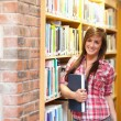 Cute young female student holding a book - 图库照片