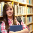 Stock Photo: Calm female student posing