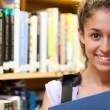 Happy female student holding a book — Stock Photo