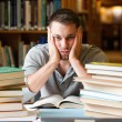 Depressed student having a lot to read — Stock Photo