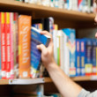 Stockfoto: Handsome male student picking a book