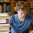 Portrait of a male student reading — Stock Photo #11193591