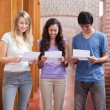 Students reading a piece of paper — Stock Photo