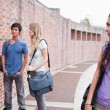 Lonely student looking at her classmates talking — Stock Photo