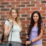 Beautiful students posing — Stock Photo