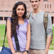 Portrait of a student couple posing - Stockfoto