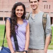 Portrait of a smiling student couple posing - Stockfoto