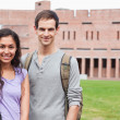 Smiling student couple posing - Stockfoto