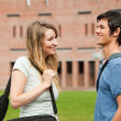 Foto Stock: Young student couple flirting