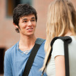 Portrait of a surprised student talking with a friend — Stock Photo #11193843