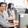 Smiling fellow students in an IT room — Stock Photo #11193934