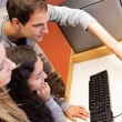 Fellow students using computer — Stock Photo #11193950