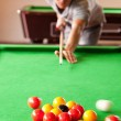 Portrait of a man starting a pool game — Stock Photo
