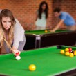 Woman playing snooker - Stock Photo