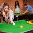 Royalty-Free Stock Photo: Portrait of a woman playing snooker