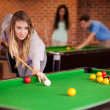 Portrait of a student woman playing snooker — Stock Photo #11194245